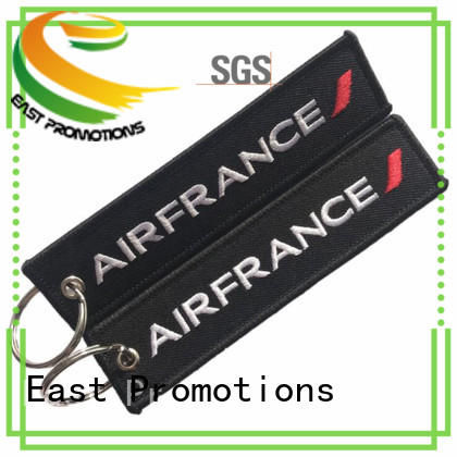 East Promotions remove before flight keychain wholesale for sale